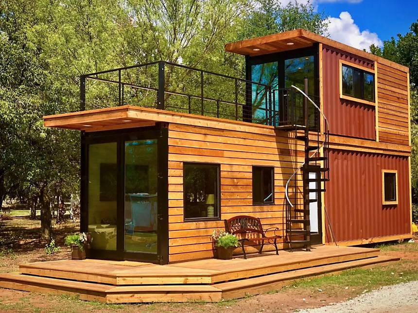 Storey stacked shipping container home with a roof terrace