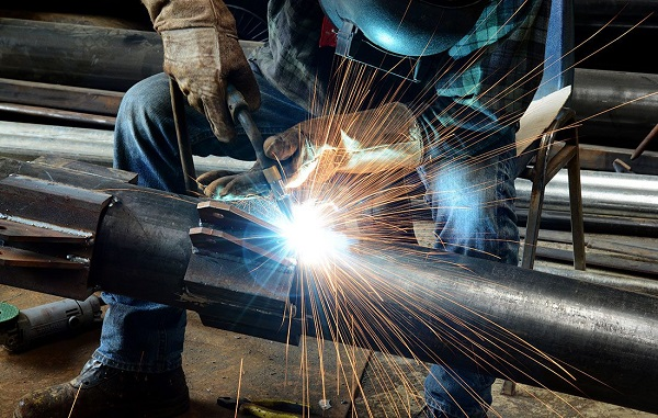 Image Of A Craftsman Welding A Stainless Steel Metal In A Steel Industry.